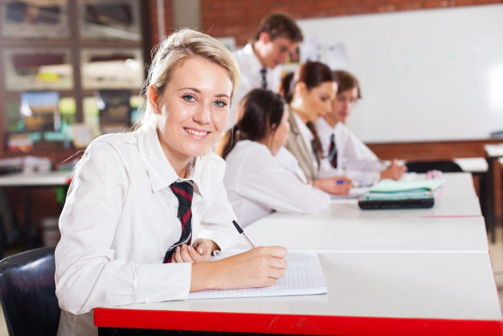 middle school girl student sitting in classroom