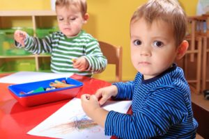 little boys coloring at a preschool