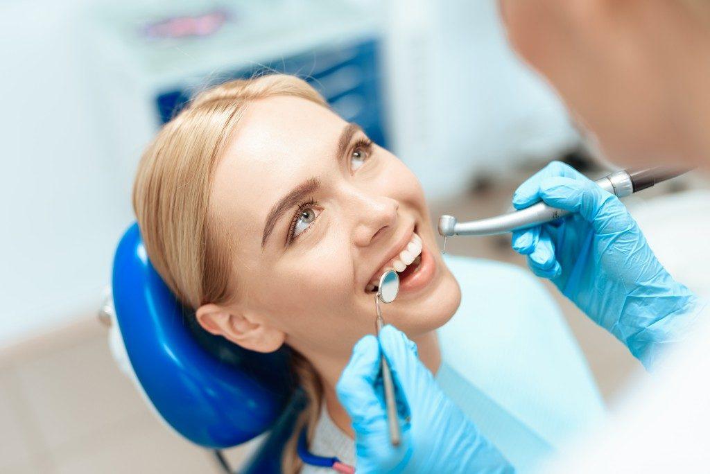 Dentist checking woman's teeth