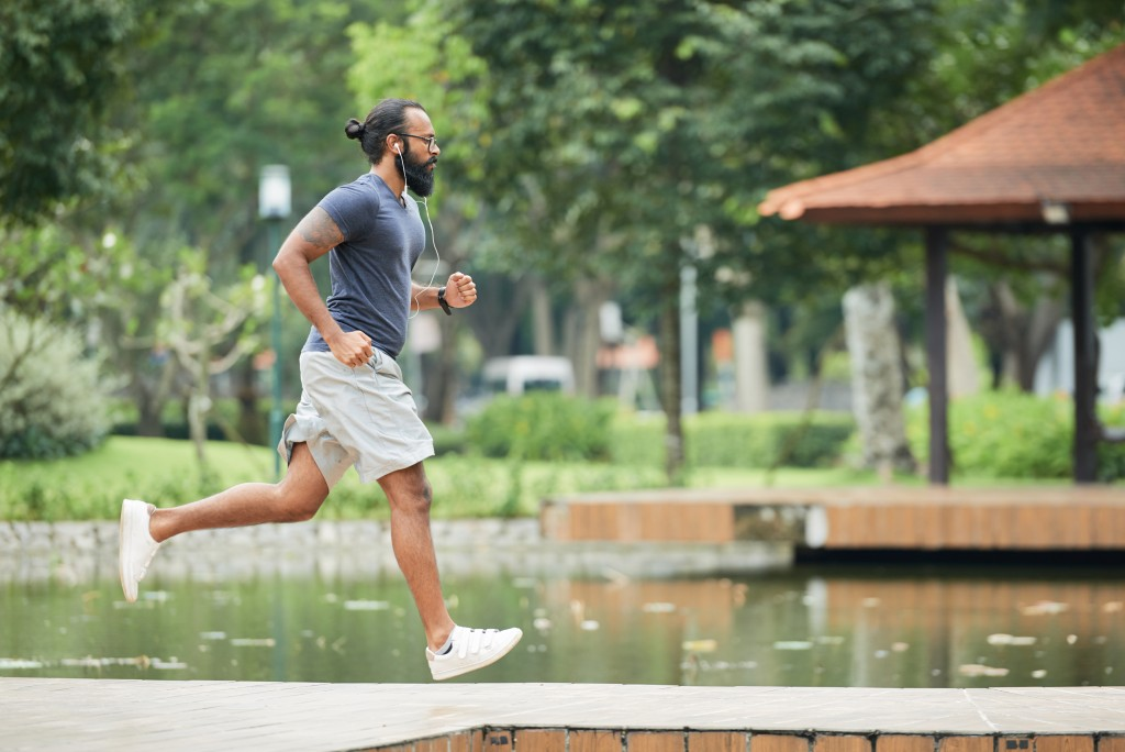man jogging at the park