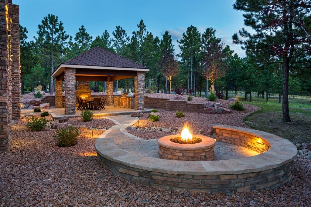 fire pit in a spacious lawn