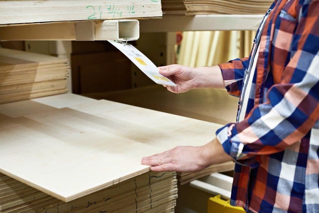 Man choosing a plywood to buy