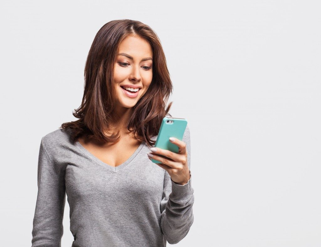 Woman using mobile app on phone