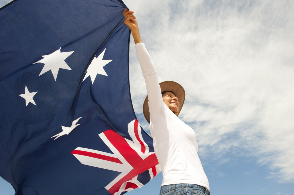 woman carrying the flag of Australia