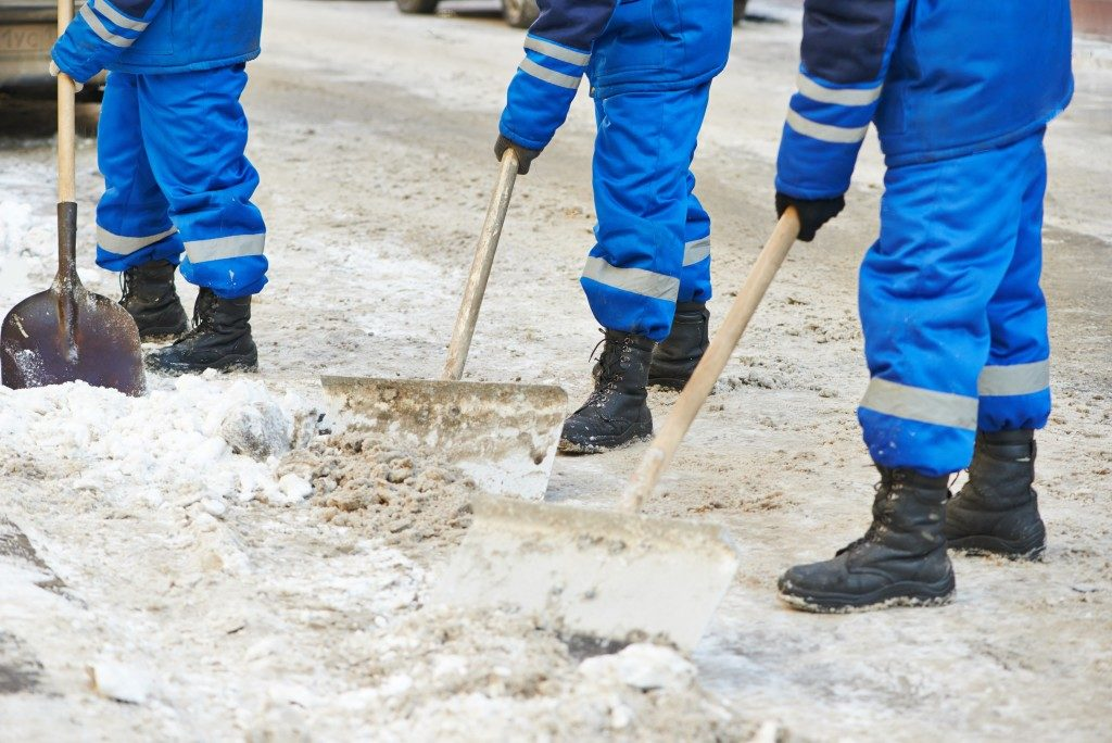 shoveling snow during winter