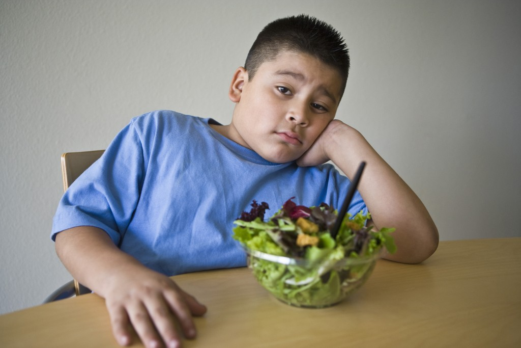 Portrait of an obese preteen boy on a diet