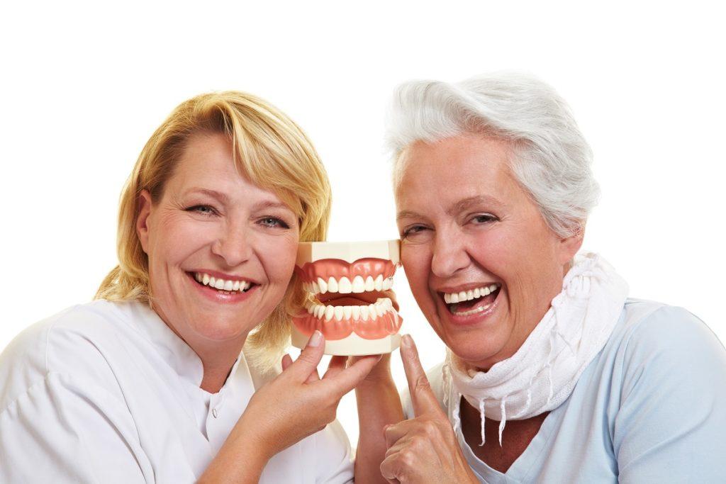 Women holding a teeth