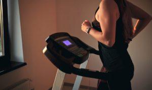 woman using her treadmill