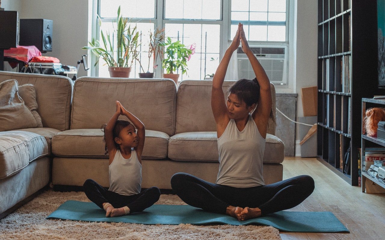 child stretching with parent