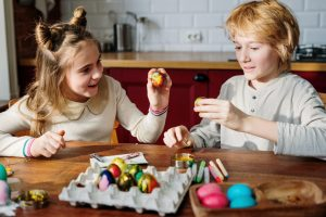 kids playing with easter eggs