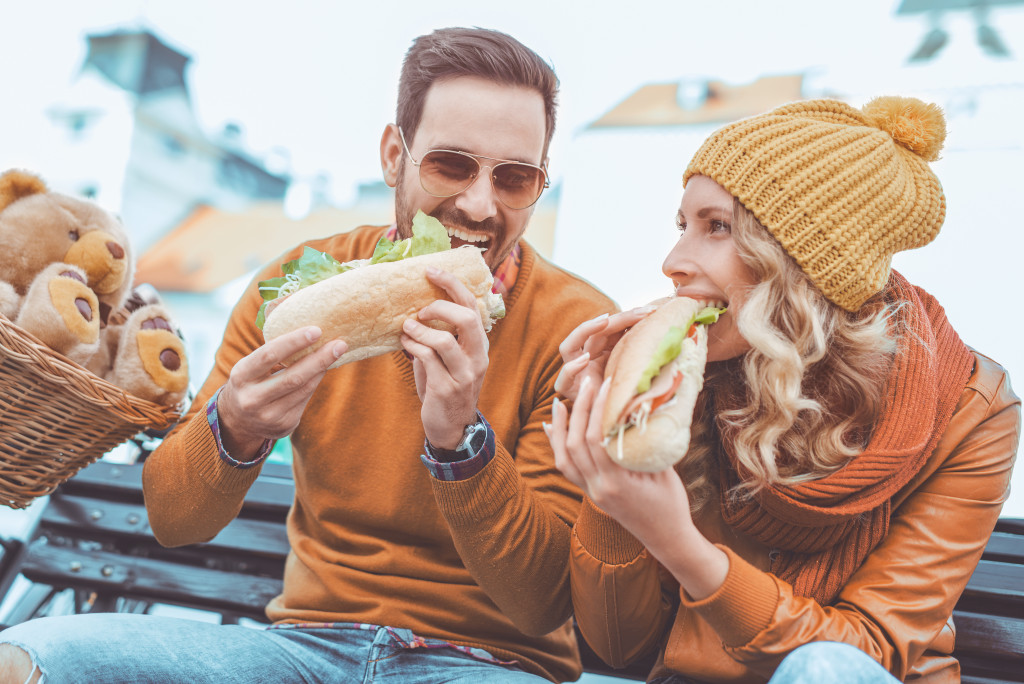 two people eating together