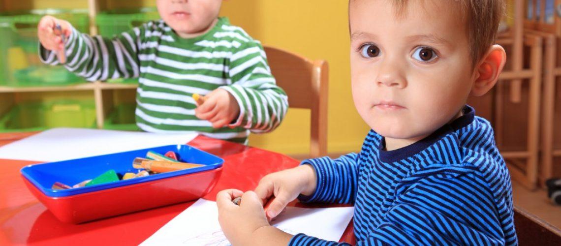 little boys coloring at a preschool