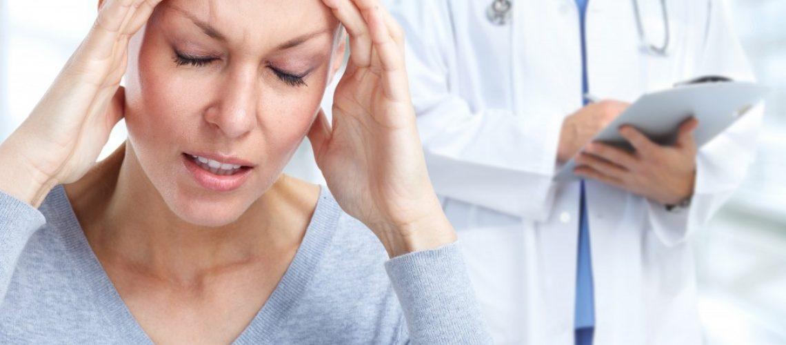 woman having a bad headache