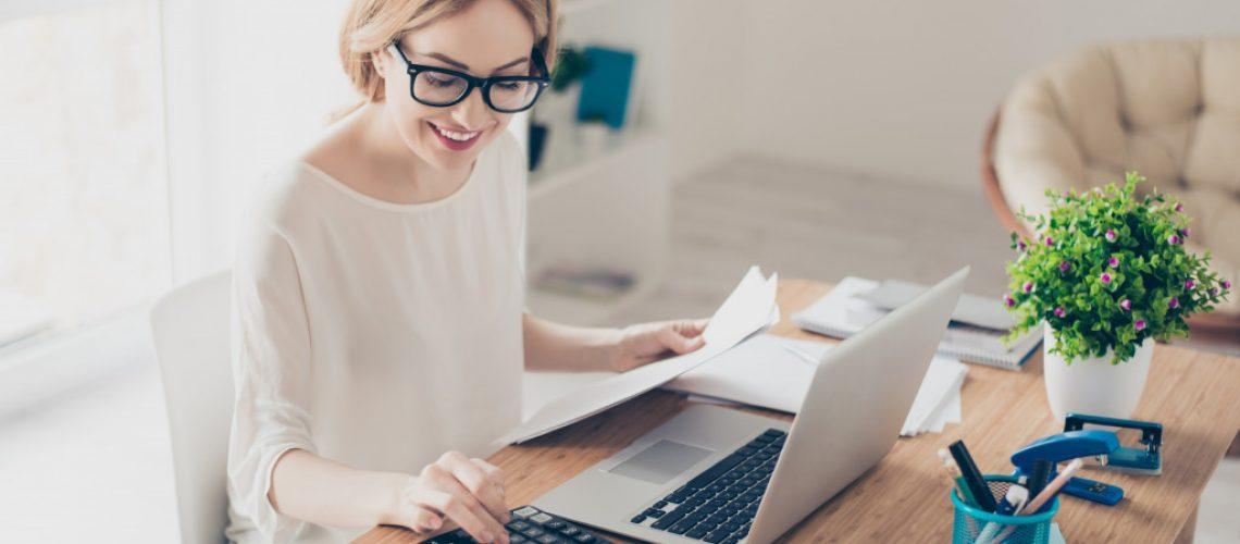 person computing finances