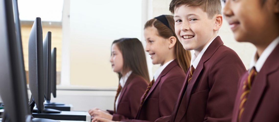 Pupils Wearing School Uniform In Computer Class
