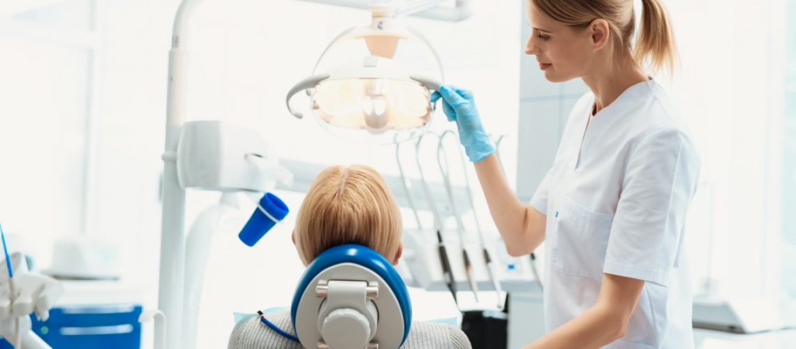 Patient with dentist sitting on dentist chair