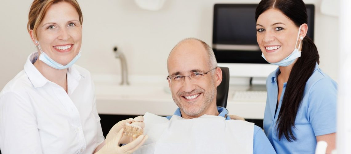 old man and denstist at the dental clinic