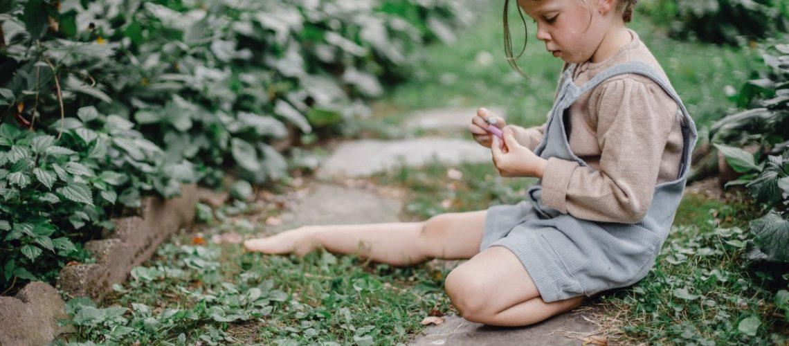child in a backyard