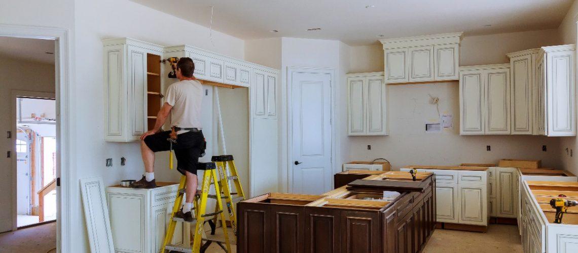 man building a kitchen